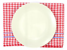 Off white plate on red Royalty Free Stock Photos