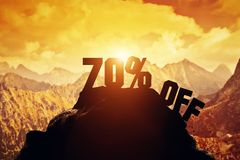 70% off writing on a mountain peak. 3d Stock Photography