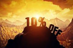 10% off writing on a mountain peak. Stock Photo