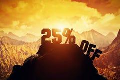 25% off writing on a mountain peak. Stock Photos