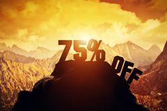 75% off writing on a mountain peak. Royalty Free Stock Image
