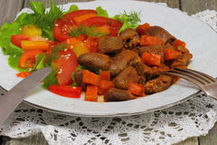 Offal. Chicken offal with fresh vegetables Shallow DOF stock photos