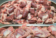 Offal chicken gizzards and hearts. In the container Stock Photography