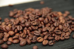 Сoffee beans on bamboo tablecloth Royalty Free Stock Images