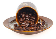 Сoffee beans in a inverted cup Stock Photography