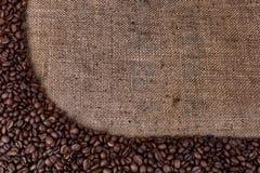 Сoffee beans on vintage sackcloth. Royalty Free Stock Photos