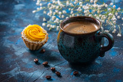 offee in blue cup, and delicious cakes on dark blue background Royalty Free Stock Photos