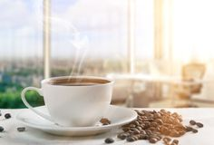 Сoffee. A drink made from the roasted and ground beanlike seeds of a tropical shrub, served hot or iced Stock Image