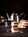 ?offee fruit candy tea and teapot on dark wooden table. Stock Photography