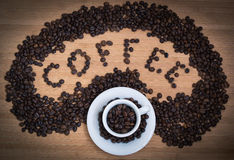 Сoffee heart. Word of coffee from coffee beans and white cup Stock Photo