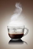 Сoffee and water in cup  on white Stock Photography