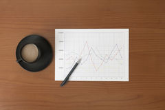 Offee on worktable covered with documents close up Royalty Free Stock Photography