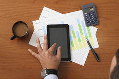 Offee on worktable covered with documents close up Stock Photos