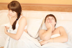 Offence. Young couple in a bedroom at home. Family conflict Stock Photos