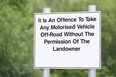 Offence to take any motorised vehicle off road with landowner permission sign. Uk royalty free stock photos