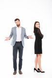 Offence young loving couple standing isolated. Image of offence young loving couple standing isolated over white background Royalty Free Stock Photo
