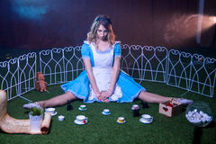Offended Alice in Wonderland. Blowing lips Stock Photography