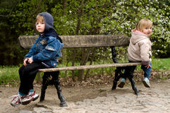 Offended on a bench. The offended boy and the girl sit on a bench in park Royalty Free Stock Photos