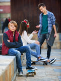 Offended boy and couple of teens apart Royalty Free Stock Photography