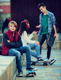 Offended boy and couple of teens apart Royalty Free Stock Image