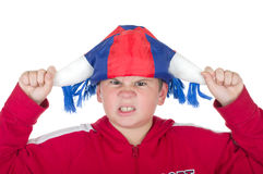 Offended  boy in a fan helmet. On a white background Royalty Free Stock Photo