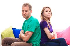 Offended boy with a girl on the sofa at home Royalty Free Stock Photography