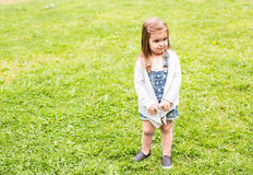 Offended child portrait. Outdoors portrait of small cute girl with offended look Royalty Free Stock Photos