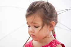 Offended child. The offended child with umbrella Royalty Free Stock Photos