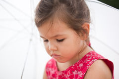 Offended child. The offended child with umbrella Royalty Free Stock Photography