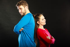 Offended couple back to back after argument. Royalty Free Stock Photo