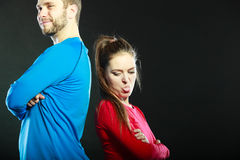 Offended couple back to back. Funny woman. Stock Photos