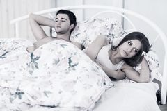 Offended couple in bed Royalty Free Stock Image