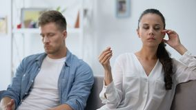 Offended couple in quarrel at home, woman holding engagement ring, divorce. Stock footage stock footage