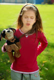 The offended girl. In park a sunny day stock photography