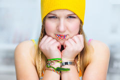 The offended girl with easter candies on lips Stock Image
