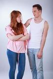 Offended girl with her boyfriend Stock Photos