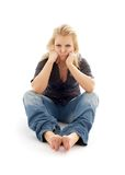 Offended girl sitting on the floor Royalty Free Stock Images