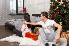 Offended girl upset about the wrong gift of her boyfriend while Stock Photo
