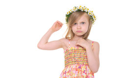 Offended girl with wreath of daisies Royalty Free Stock Image
