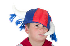 Offended little boy in a fan helmet. On a white background Royalty Free Stock Image