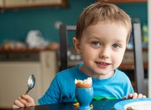 Offended little boy refuses to eat dinner. Spaghetti stock photography