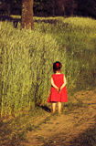 The offended little girl in red dress Royalty Free Stock Image