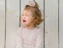 Offended little girl weeping Stock Photography