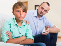 Offended man and stubborn teenager Royalty Free Stock Photos
