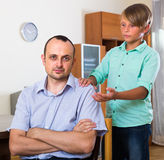 Offended man and stubborn teenager Royalty Free Stock Image