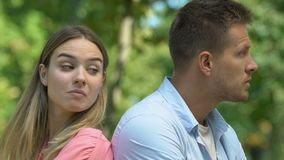 Offended man and woman sitting back each other, relationship crisis, quarrel. Stock footage stock video footage