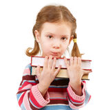 Offended preschool child holds textbooks Royalty Free Stock Image