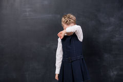 Offended Schoolgirl Stands At The Blackboard Stock Images