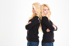 Offended sisters twins Royalty Free Stock Images