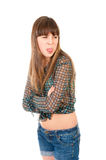 Offended teen girl shows her tongue Royalty Free Stock Photo